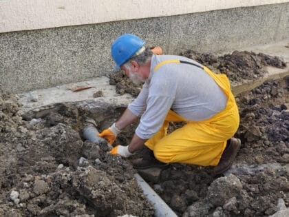 Home,Renovation,,Plumber,Fixing,Sewerage,Pipe,At,Construction,Site